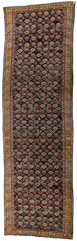 A Kurdish runner  Northwest Persia size approximately 5ft. 6in. x 18ft. 4in.