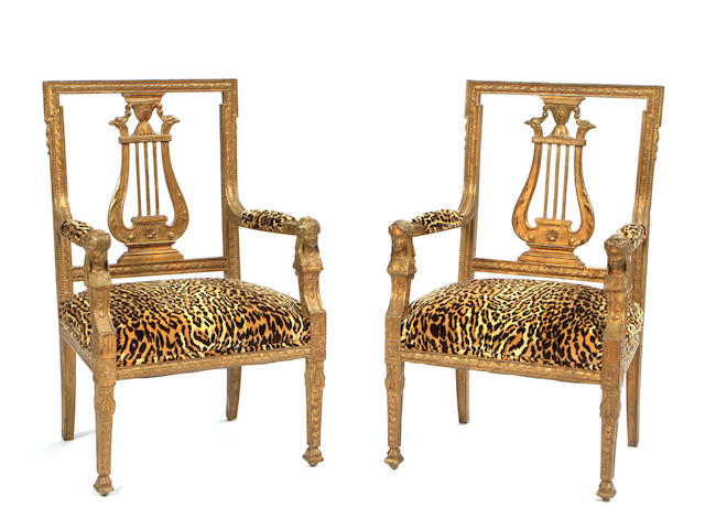 A pair of Italian Neoclassical style upholstered giltwood armchairs