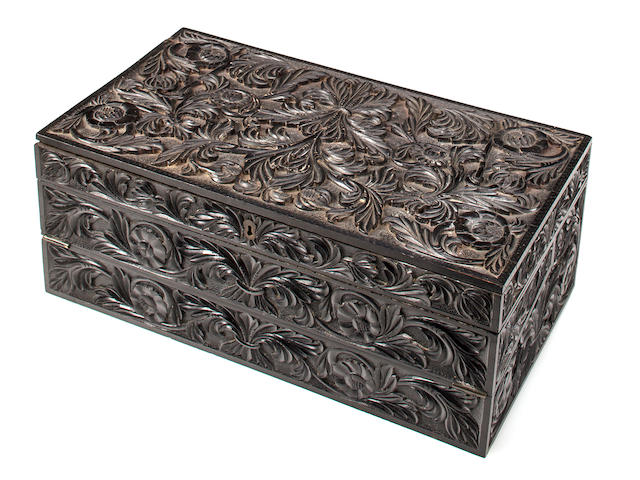 An Anglo Indian carved ebony and ivory inlaid portable desk<BR />late 19th century