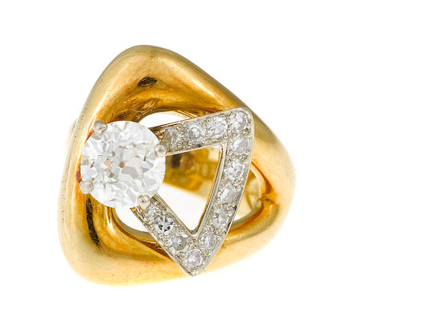 A retro 1.25cts. approximate old European-cut diamond and bicolor gold ring