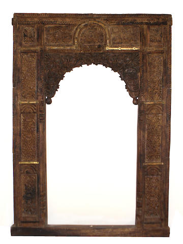 An Indian carved door and surround