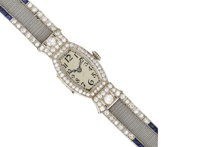 An art deco diamond, synthetic sapphire and platinum bracelet wristwatch