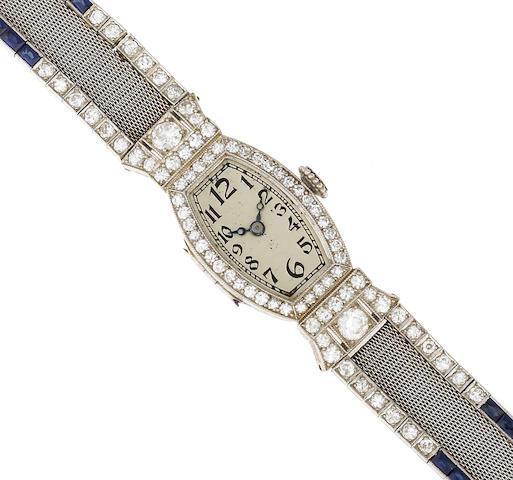 An art deco diamond, synthetic sapphire and platinum bracelet wristwatch