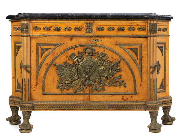 A Louis XVI style gilt bronze mounted maple commode à vantaux