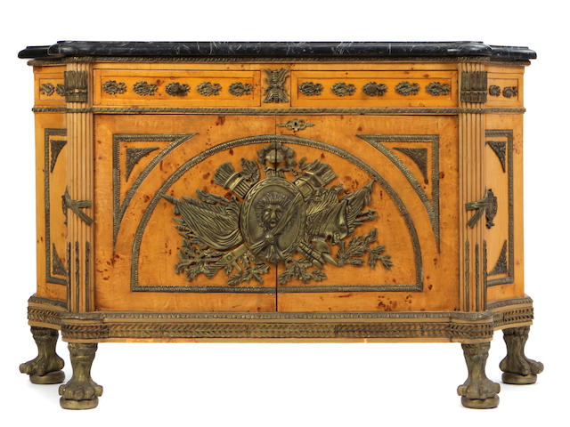 A Louis XVI style gilt bronze mounted commode à vantaux