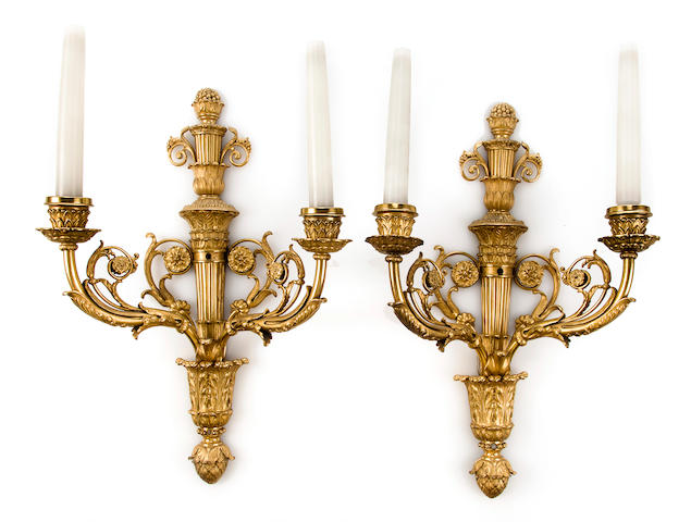 Pair of Louis XVI style two-light wall appliques, first half of the 20th c., gilt bronze and gilt metal, fitted for electricity, l x w: 18 ¼ x 12in. (46 ½ x 30cm)