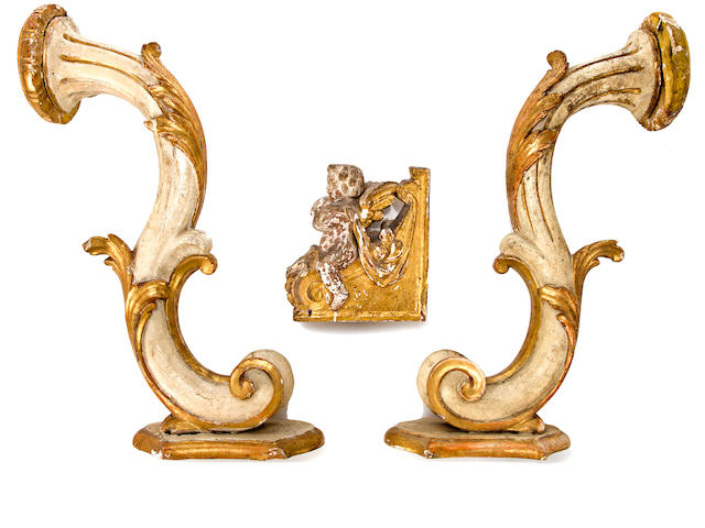 Pair of Baroque style bras de lumiere 	Continental, late 19th c.  	cream painted and parcel gilt wood  	l x h: 22 x 11in. (50 x 28cm)  	together with:  	Baroque style architectural element 	Continental, 19th c.  	l x h: 7 x  8in. (18 x 20.5cm)
