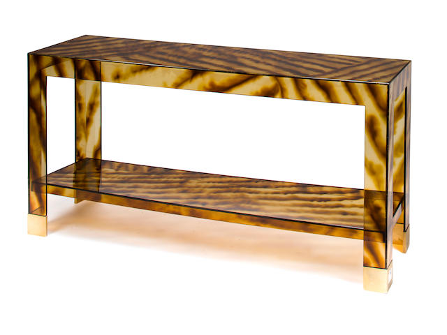 Console table, 1970s, tortoiseshell colored acrylic and brass, h x l x d: 27 ¾ x 55 x 15 1/2in. (70.5 x 139.5 x 39.5cm)