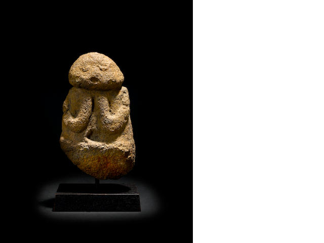 A stone figure - Ti'i height 14in (35cm); diameter 8in (20.3cm)