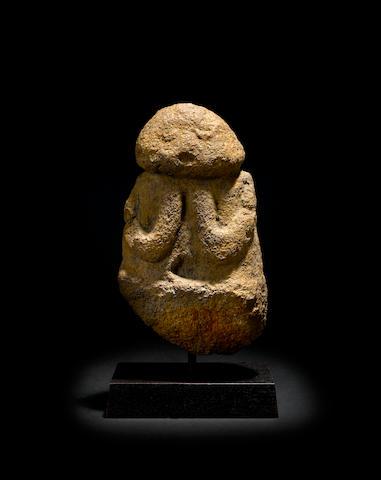 A stone figure - Ti'i height 14in (35cm); diameter 8in (20.3cm)