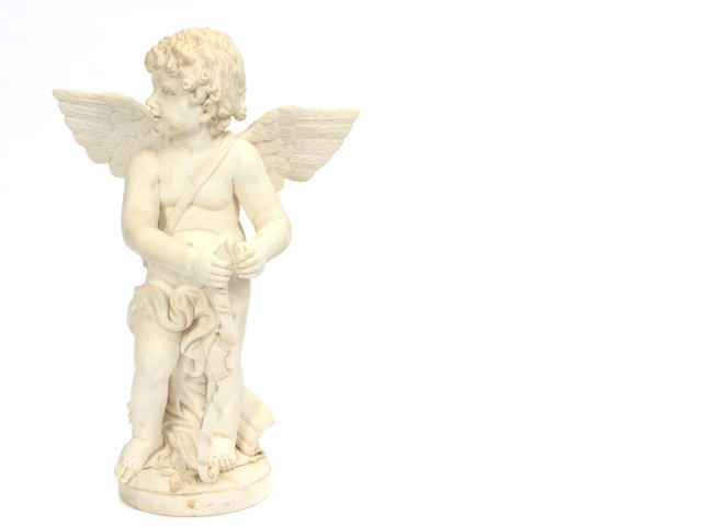 A carved marble figure of a cherub