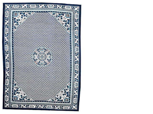 A Chinese carpet  China  size approximately 11ft. 10in. x 16ft. 6in.