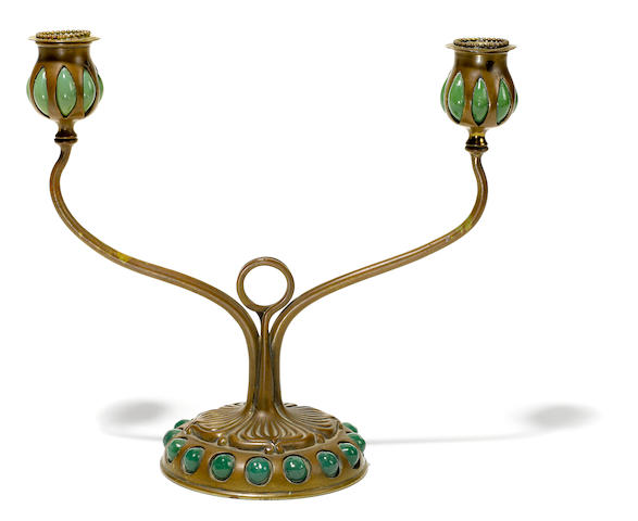 A Tiffany Studios Favrile blow out and jeweled glass and patinated bronze two light candelabrum 1899-1918