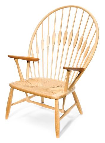 A Hans Wegner for Johannes Hansen ash and teak Peacock chair
