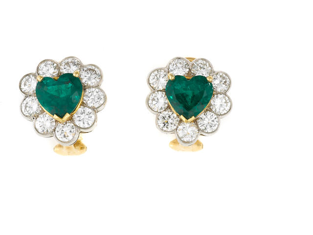A pair of emerald, diamond, 18k gold and platinum earrings