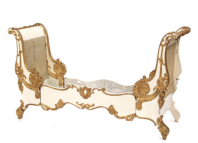 A Russian Rococo style parcel gilt paint decorated daybed