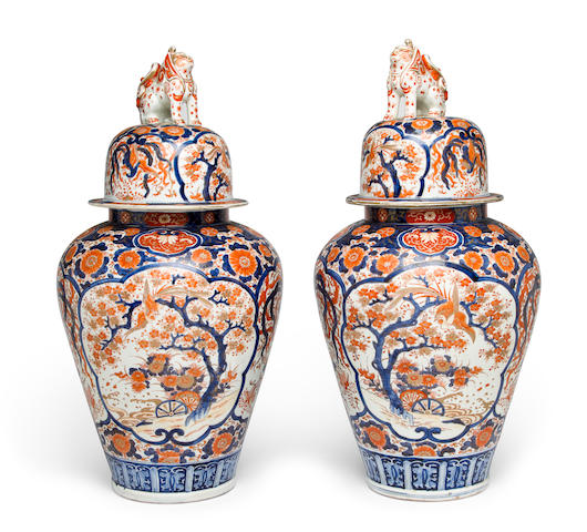 A pair of Japanese Imari porcelain large covered baluster-form jars<BR />Meiji period