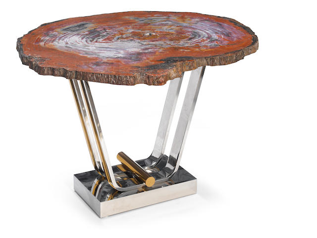 A Contemporary chrome, brass and petrified wood occasional table circa 1980