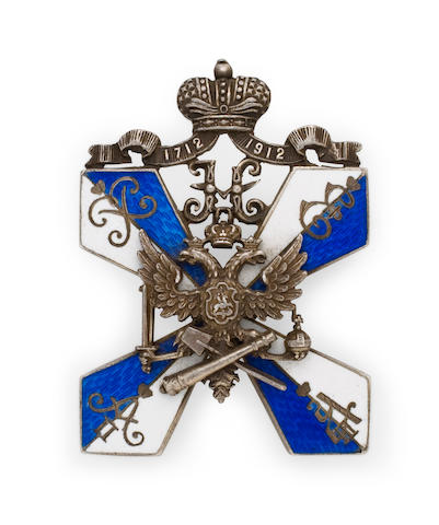 A fine Russian 88 standard silver and enamel presentation badge made for St.Petersburg Corps of Cadets by Dmitrii Osipov, St. Petersburg, 1908-1912