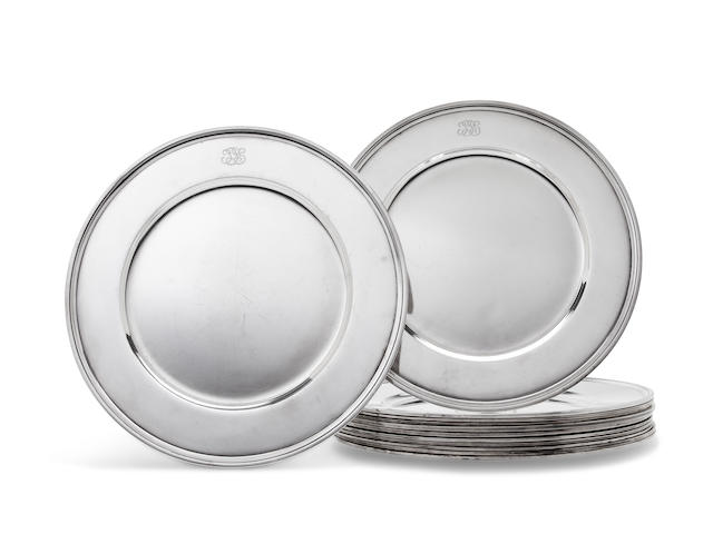 A set of twelve American sterling silver dinner plates<BR />manufactured and retailed by Tiffany & Co., New York, NY, 1907-47