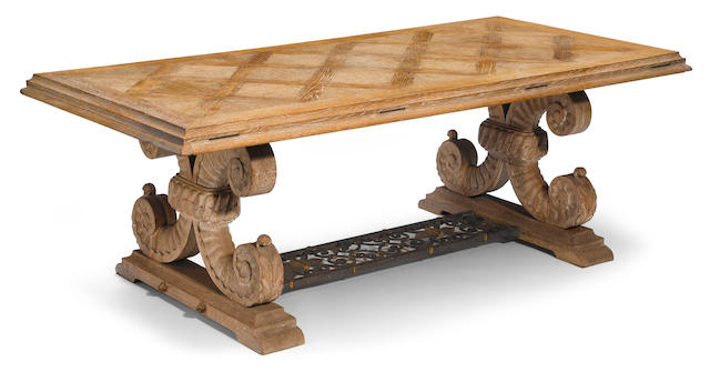 A French carved limed oak and wrought iron dining table attributed to Jean-Charles Moreaux, circa 1940