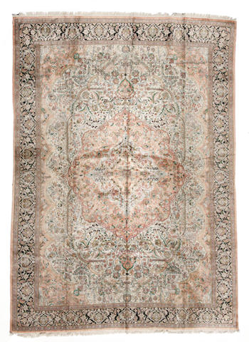 A Kashmiri carpet size approximately  15ft. 8in. x 11ft. 7in.