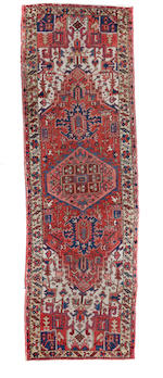 A group of four Northwest Persian rugs size of largest approximately 4ft. 6in. x 5ft. 4in.