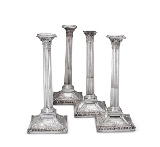 A set of four Sheffield plated Corinthian columnar-form stop-fluted candlesticks<BR />late 18th century