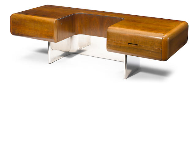 A Stow & Davis walnut and stainless steel desk designed by M.F. Harty, 1970s
