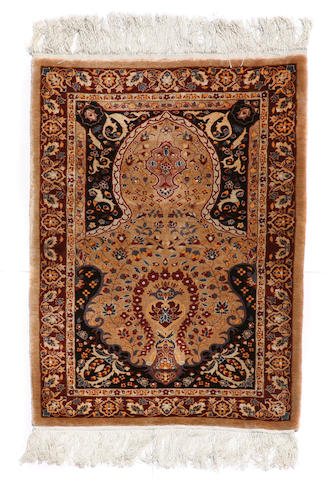 A Chinese rug size approximately 2ft. 8in. x 4ft. 3in.