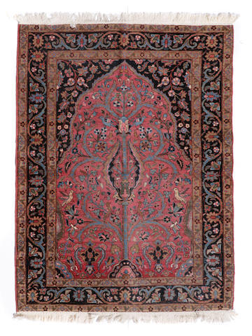 A Sarouk rug size approximately 4ft. 6in. x 6ft. 2in.