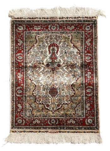 A Chinese rug size approximately 2ft. 1in. x 3ft.