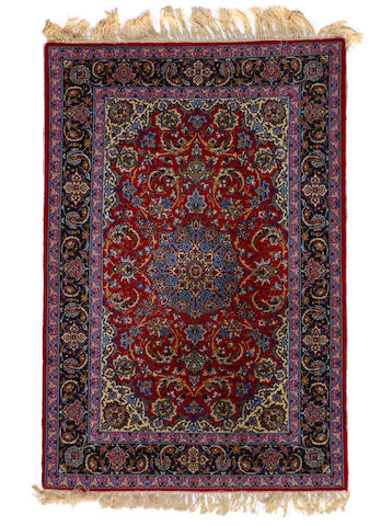 An Isphahan rug  size approximately 43in (109cm) x 56in (165cm)