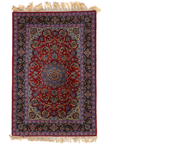 An Isphahan rug  size approximately 3ft. 7in. x 5ft. 5in.