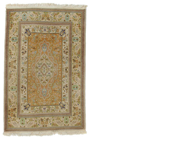 A Taba Tabriz rug size approximately 3ft. 8in. x 5ft. 8in.