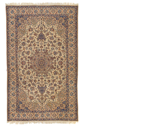A Nain carpet size approximately 5ft. 10in. x 9ft. 10in.