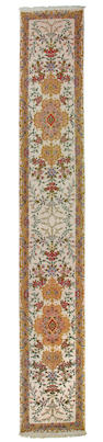 A Tabriz runner size approximately 2ft. 8in. x 17ft. 4in.