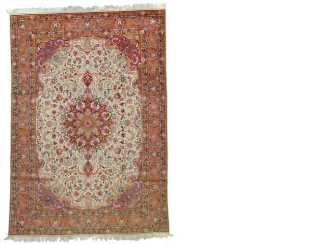 A Tabriz carpet size approximately 8ft. 9in. x 11ft. 9in.