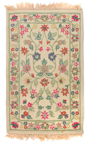 A Chinese Chain stitch rug size approximately 3ft. 5in. x 5ft. 6in.
