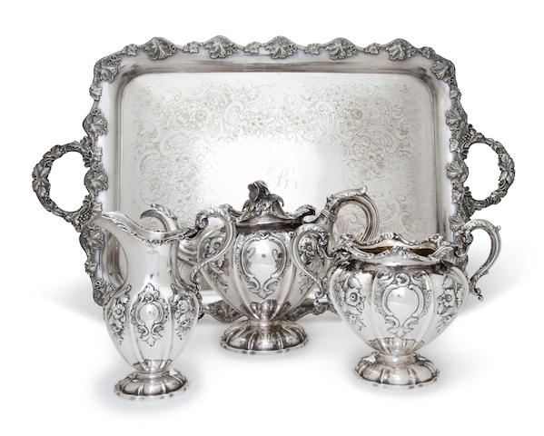 A Scottish Victorian sterling silver three-piece tea service and a similar silver-plated two-handled tray<BR />Leonard Urquhart, Edinburgh, 1840