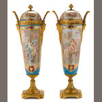 A pair of Sèvres style porcelain gilt bronze mounted covered vases<BR />late 19th/early 20th century
