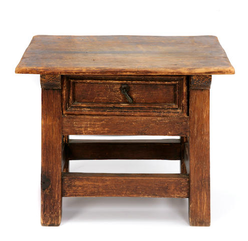 A Continental Baroque style oak side table