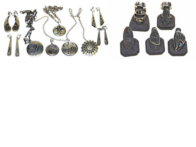 A collection of Hopi overlay jewelry items