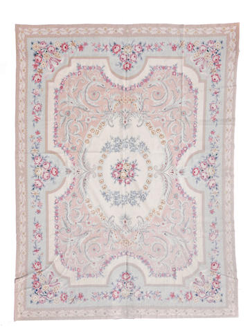 A Chinese needlepoint rug size approximately 7ft. 9in. x 9ft. 10in.
