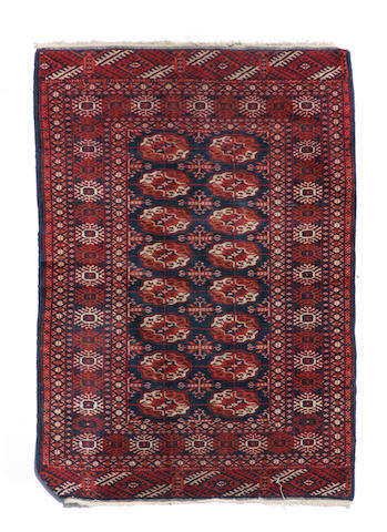 A Turkoman rug size approximately 3ft. x 5ft.