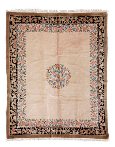 A Chinese rug size approximately 8ft. x 10ft.
