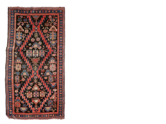 A Turkish rug size approximately 3ft. 9in. x 7ft. 5in.