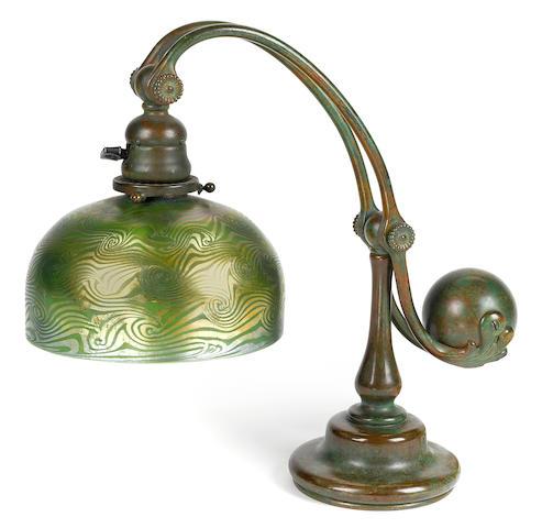A Tiffany Studios Favrile glass and patinated bronze counterbalance desk lamp circa 1910