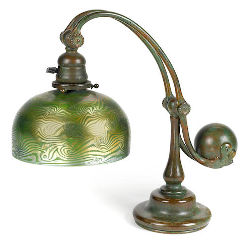 A Tiffany Studios Favrile glass and patinated bronze counterbalance desk lamp circa 1910