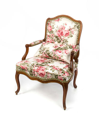 Louis XV Fauteuil, mid 18th c., carved and molded beechwood upholstered in rose chinz, h x w x d: 39 x 29 x 22 1/2in. (99 x 73.5 x 57cm)